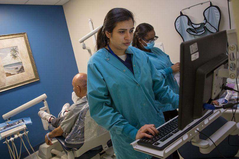 Medical technician at computer